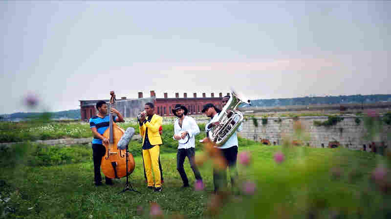 Jon Batiste Leads A Private Street Parade Atop A Fort