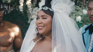 Clad In Bridalwear, Lizzo Sings To The Worthiest Possible Object Of Her Affection